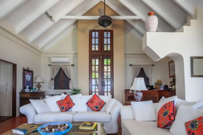 Soaring ceilings and lovely architectural details in the spacious great room.