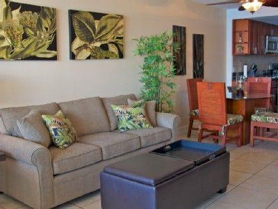 Unwind and kick your feet up in this plush and inviting living room