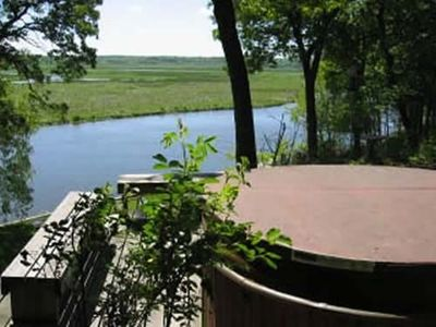Enjoy the hot tub and river views winter, spring, summer and fall.