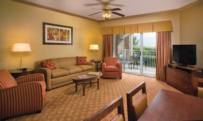 Each side of the suite features a living area with a queen sleeper sofa.