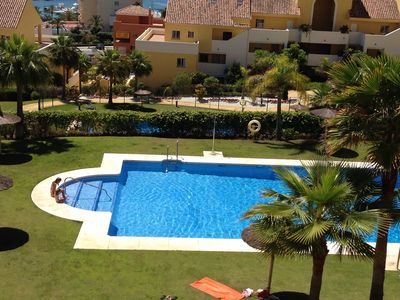 One of the pools with parasols & sunbeds
