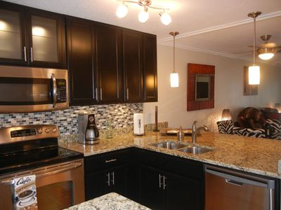 Brand new renovated kitchen with granite & new stainless appliances.