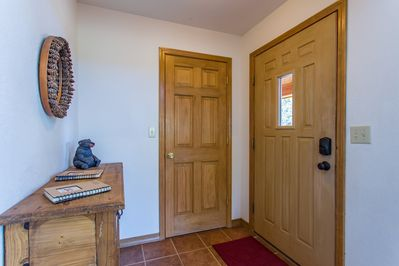 Lovely front entrance with a large coat closet.