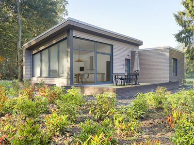 Photo for Chalet with modern furnishings, located at the green edge of a holiday park with swimming pool