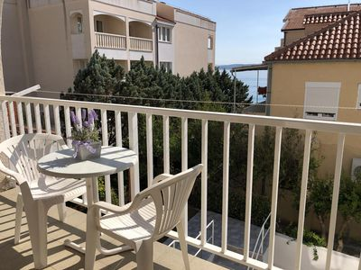 Photo for Two bedroom apartment with terrace and sea view Baška Voda, Makarska (A-2756-e)