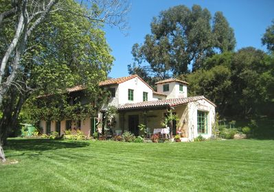 Nearly an acre of landscaped grounds surround the house (side view)