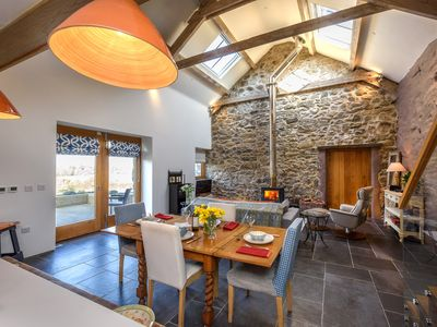Photo for A breathtaking and stylish barn conversion lying on a private estate on the outskirts of the seaside