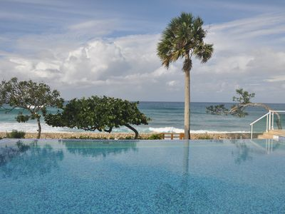 Photo for Luxury 3-Bedroom Condo on a Sandy Beach with Pool and Jacuzzi