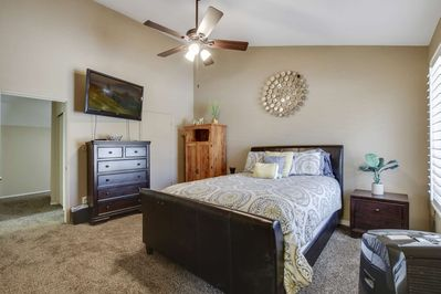 Master bedroom with tv and large private bathroom