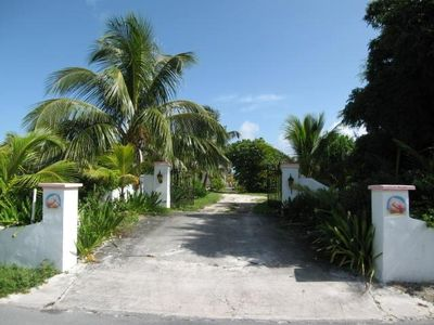 The gated entrance to Conch Shell Beach Villa, large beachfront estate lot.