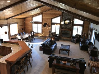"""Great Room - 1100sf with 60"""" HDTV, wood chess table and access to rear deck"""