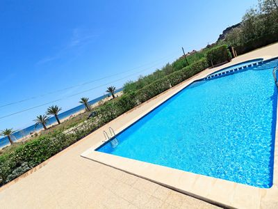 Photo for Car4 Ground floor, 1st line of the beach, swimming pool, WIFI, AC, PK, SAT