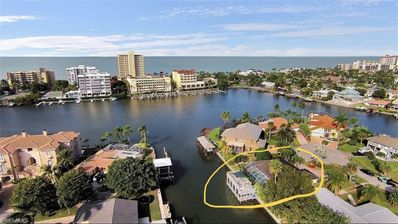 Photo for Naples Waterfront Home with Pool, Dock, Boathouse walk to Vanderbilt Beach