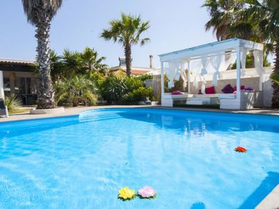 Photo for 5 bedroom Villa, sleeps 13 with Air Con, FREE WiFi and Walk to Beach & Shops