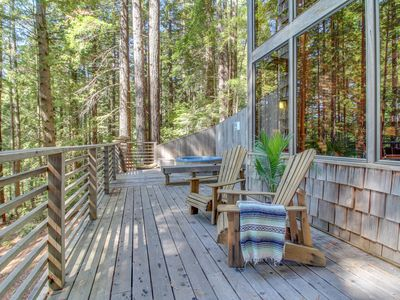 Photo for Romantic woodland home w/ private hot tub, deck & gorgeous forest/ocean views!
