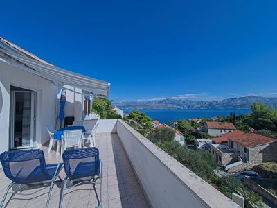 Photo for Two bedroom apartment with terrace and sea view Postira (Brač)