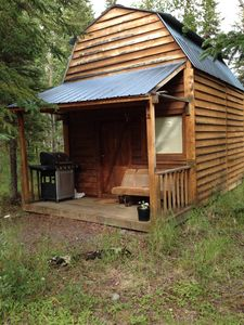 The front porch has a comfortable seat and a gas grill for your use.