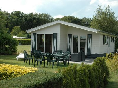 Photo for Neatly furnished chalet, located in a park with a swimming pool and in beautiful nature