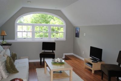 Entrance and living area.  Pull out queen sized bed.  Lots of beautiful llight.