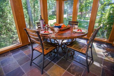 The breakfast nook overlooks the park-like grounds outside