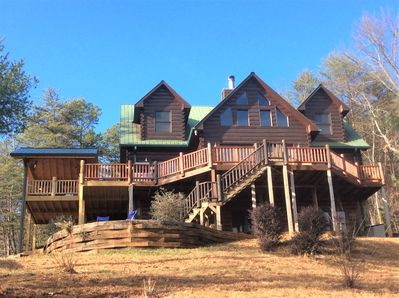 Large wrap around deck and fire pit area overlooking 500 acres of wilderness