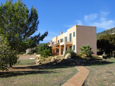 Photo for Spacious villa with huge swimming pool and large plot within walking distance from Es Cubells