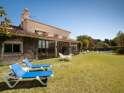 Photo for 6 bedroom villa with heated pool and just a short walk to the beach.