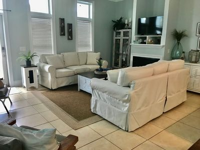 """Kick back, relax, and unwind on our cozy couches or enjoy the 42"""" TV."""