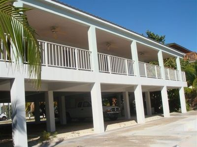 Plenty of parking and balcony overlooks canal with electronic boatlift, grill,