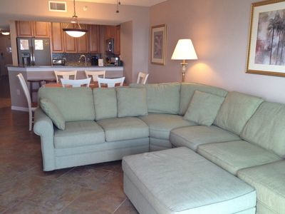 Large sectional sofa, dining room table (seats six) and new kitchen.