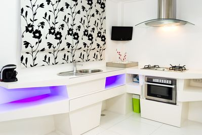Our Beautiful Kitchen seen from our Dinning Table with a mini Plasma TV to even watch your best shows.