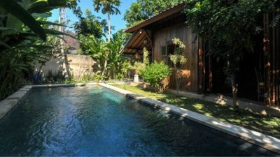 Photo for Private Lovely Teak Joglo Houses with tropical garden & pool