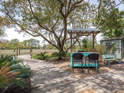 Photo for Must See Renovation! Beautiful Creekfront Cottage, 2 Screened Porches, Pet Friendly with Fenced Yard