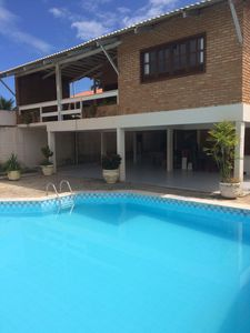 Photo for 06 air-conditioned suites 40 meters from the main beach with pool and games room
