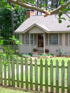 Pine Grove Cottage sheltered in a grove of tall pines and beautiful hardwoods.