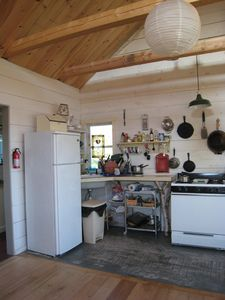 Cook in the small, but complete, kitchen