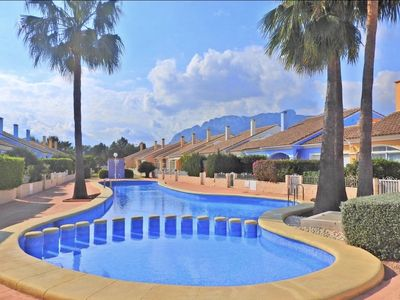 Photo for Beautiful apartment near the beach with a view of the pool and the mountain 'Segaria'