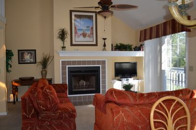 Living room decorated in a west indies theme.