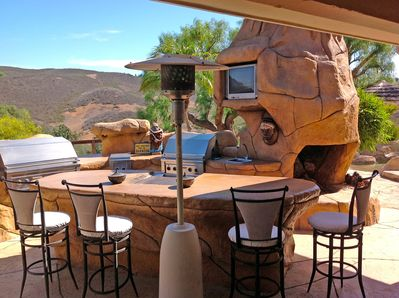 Outdoor kitchen and barbecue area with heat lamps for cool nights.