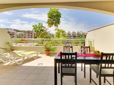 Photo for Modern condo with two huge patios, pool access, golfing, and tennis
