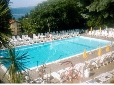 Photo for Studio with swimming pool and tennis, lake view and very close to beach and lake