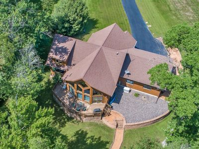 Photo for Dog-friendly lakefront home w/ large deck, on-site golf, shared pool & hot tub