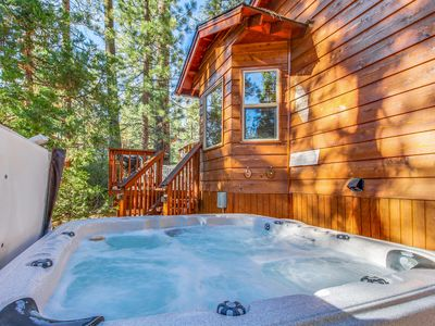 Photo for Quiet and cozy cabin w/ hot tub. Close to golf and skiing!