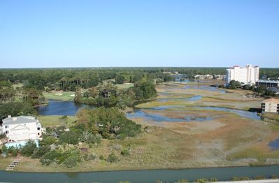 View of salt marsh and Dunes golf course from front door of the Penthouse.