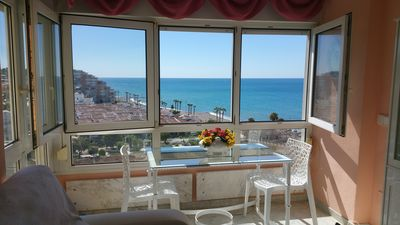 Photo for Romantic apartment at the foot of the beach with magnificent views
