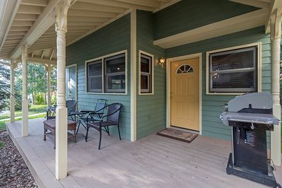Front porch with patio furniture and gas BBQ grill