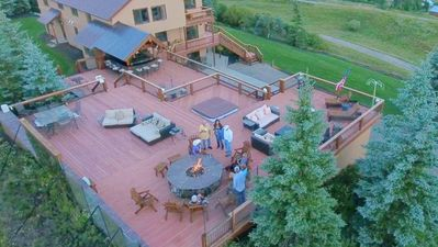 Relax around the firepit, outdoor bar, or hot tub, and enjoy the mountain view!