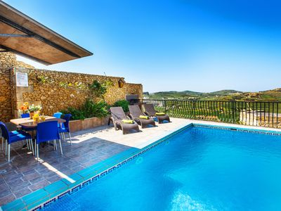 Photo for Sunny farmhouse with spectacular views , all bedrooms ensuite, private pool.