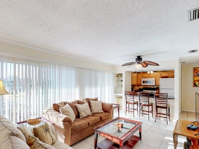 Photo for NEW LISTING! Centrally located condo w/ shared pools and tennis, near the beach