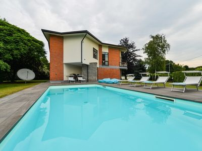Photo for Nia villa with heathed pool and lake view in Lesa